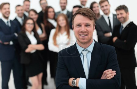 businessman standing in front of a large business team.