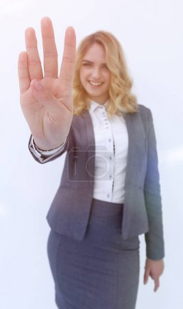 Smiling business woman showing stop sign to the camera