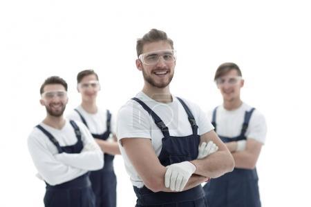 Photo pour Contremaître sur le fond de l'équipe professionnelle des travailleurs industriels - image libre de droit