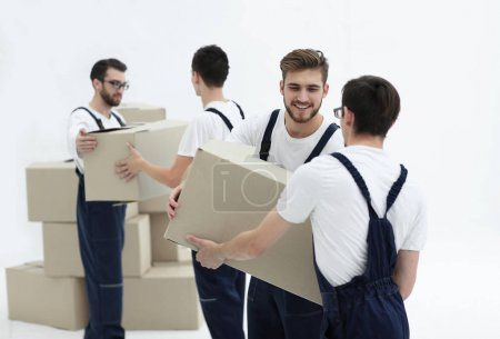 Portrait of movers holding box smiling isolated on white backgro