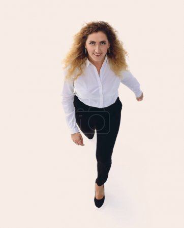 Executive business woman goes forward