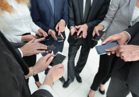 closeup.business team with smartphones.