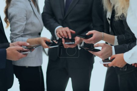 Closeup.business team using smartphones .people an...