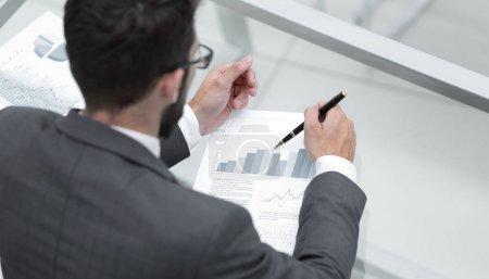 closeup.businessman working with financial data