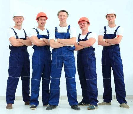 team of professional builders in helmets