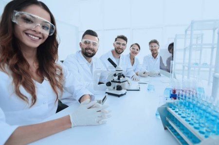 Group of young clinicians experimentation in research laboratory