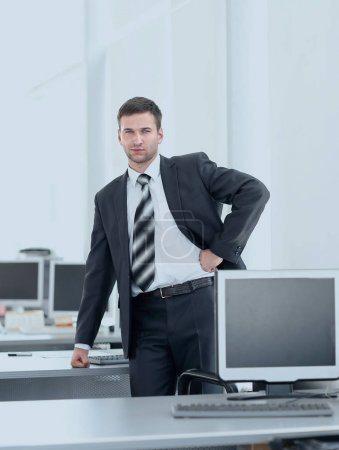 senior Manager standing in a modern office before the start of the working day
