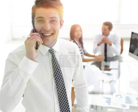 Photo for Closeup.businessman talking on a mobile phone.photo with copy space - Royalty Free Image