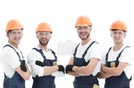 Lächelndes Bauarbeiterteam .