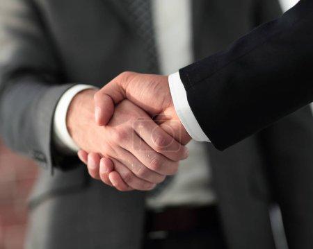 Business men giving a handshake. Business concept