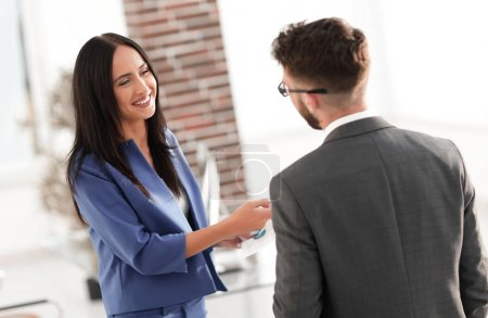 Smiling businesswoman communicating with male colleague