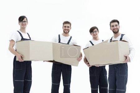 photo workers holding boxes when moving flats,