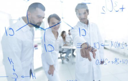 Photo for Group of laboratory scientists discussing their research in the laboratory.the concept of a scientific experiment - Royalty Free Image