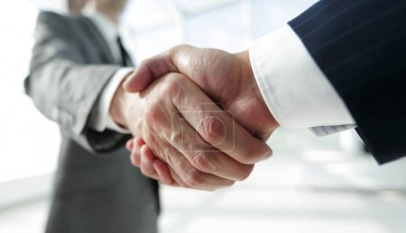 Diverse business male shaking hands.