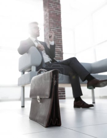 Businessman sitting on sofa in the office