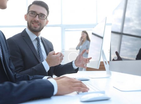 Photo for Business colleagues sitting at their Desk on blurred background office - Royalty Free Image