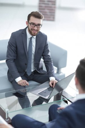 two businesspeople at computer in office