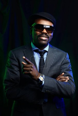 black man wearing suit and hat and sunglasses.