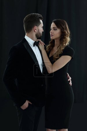 A young man and a woman looking each other