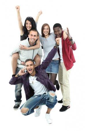 Foto de Adolescentes felices divertirse buen tiempo aislado sobre fondo blanco - Imagen libre de derechos