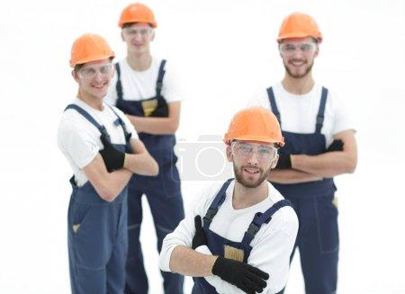 Photo pour Close seup.the contremaître et l'équipe de construction isolé sur blanc - image libre de droit