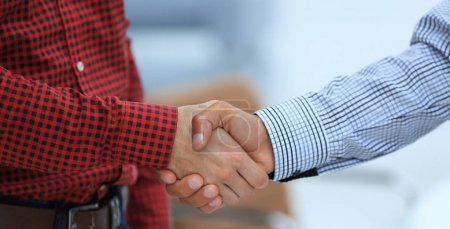 Photo for Closeup of a business hand shake between two colleagues.concept of cooperation - Royalty Free Image