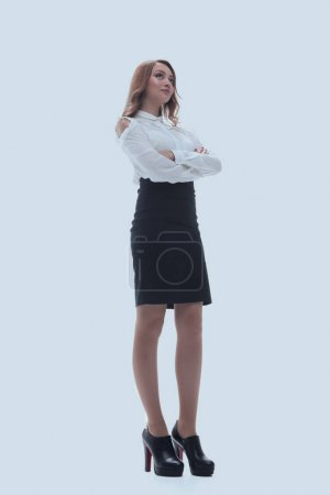 Photo for Full length portrait of an attractive professional woman wearing a suit and heels, isolated on white background. - Royalty Free Image