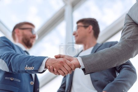Photo for Close up. background image of a business handshake in the office lobby. business background - Royalty Free Image