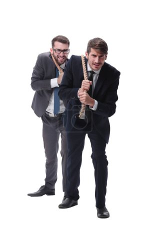 Photo for Full length . two businessmen pulling a long rope. isolated on white background. - Royalty Free Image