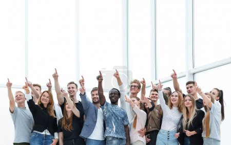 Photo for Group of happy young people pointing upwards. photo with copy space - Royalty Free Image