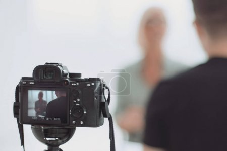 Photo for Background image is a camera filming an interview in Studio . photo with copy space - Royalty Free Image