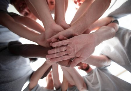 Photo for Bottom view. a high tower of the hand . the concept of unity - Royalty Free Image