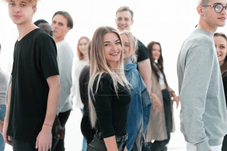 Photo for Close up. casual young woman standing among diverse young people. - Royalty Free Image