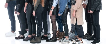 Photo for Side view. group of young people standing behind each other - Royalty Free Image