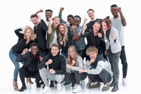 Photo pour Sur toute la longueur. groupe de jeunes heureux debout ensemble. isolé sur un blanc - image libre de droit