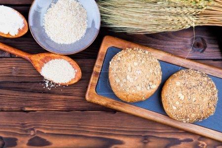 Fresh bread on a cutting board. Wooden background