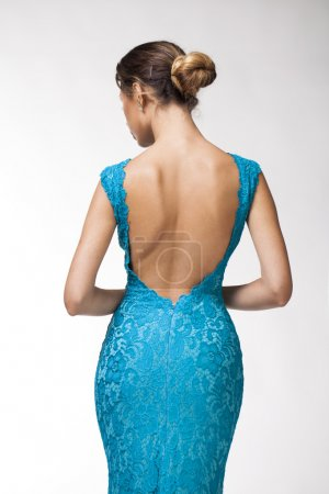 Back view, Beautiful young woman in turquoise tight clothes