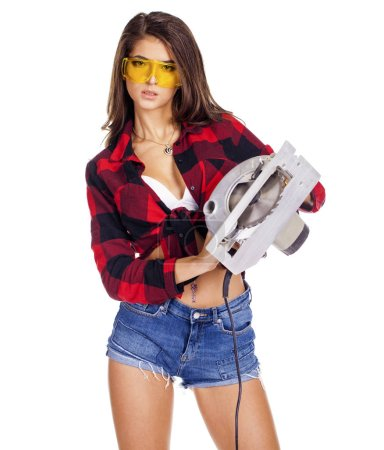 young woman shows construction tools