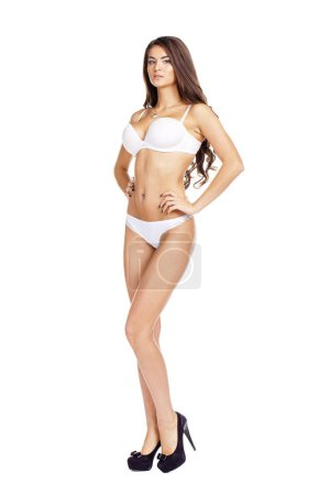 Full length beautiful slim tanned woman in bikini, isolated on w