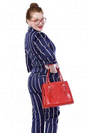 Stylish middle-aged lady in impressive checkered suit