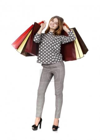 Young brunette woman with some shopping bags