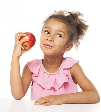 Photo for Portrait of a pretty little girl with a red apple on white background - Royalty Free Image