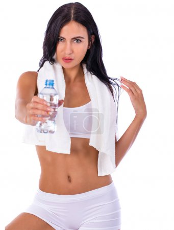 Fitness diet, Young beautiful girl drinking water from a bottle