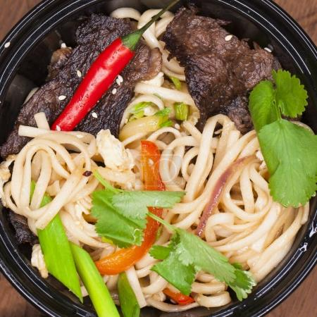 Photo for Asian cuisine, restaurant dish noodles with bits of beef - Royalty Free Image