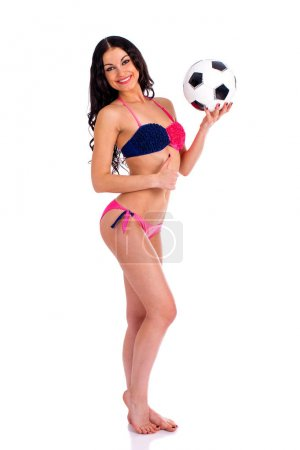 Young beautiful cheerleader with soccer ball. Full length beauti