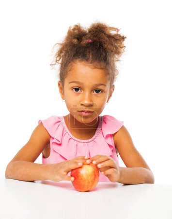 Portrait of a pretty little girl with a red apple