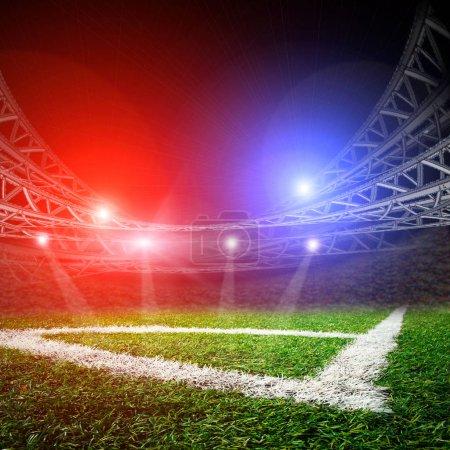 Empty football stadium with lights
