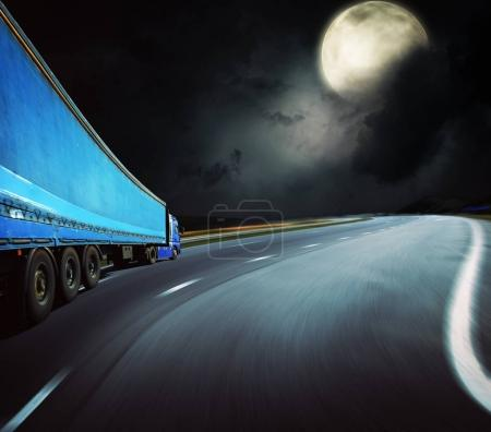 Lorry riding highway at night