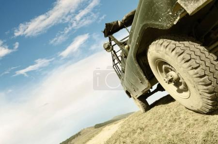 Offroad car on mountain road