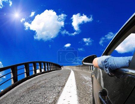 car riding on bridge